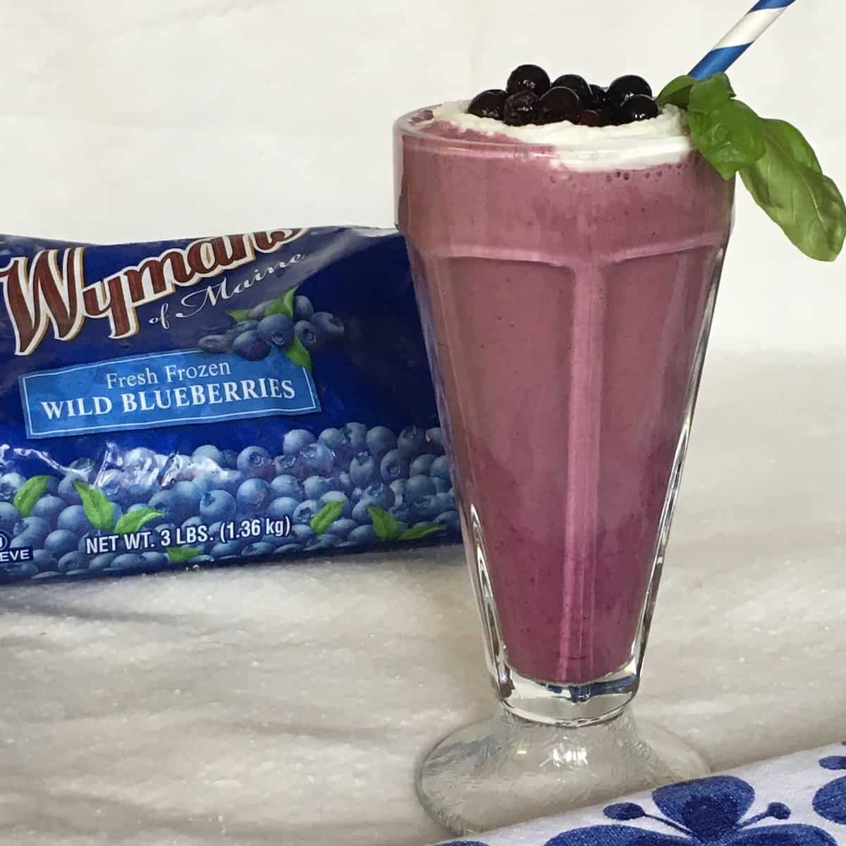 wild blueberry smoothie with a straw and product package