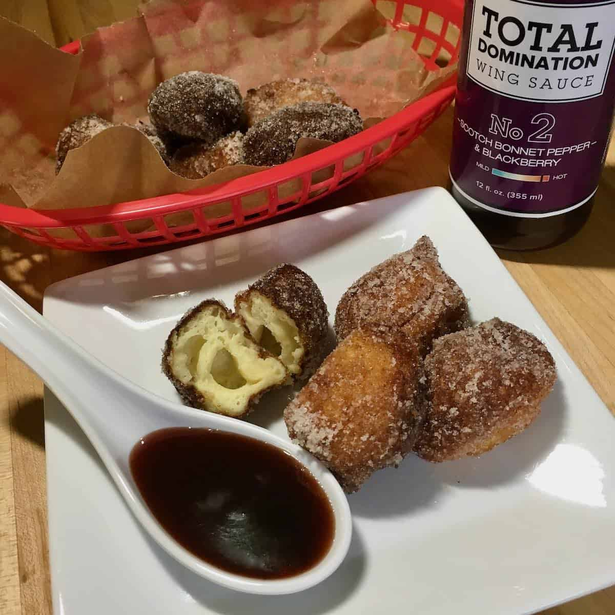 hot wing donuts or Ricotta Puffs or Fritters with scotch bonnet blackberry hot sauce