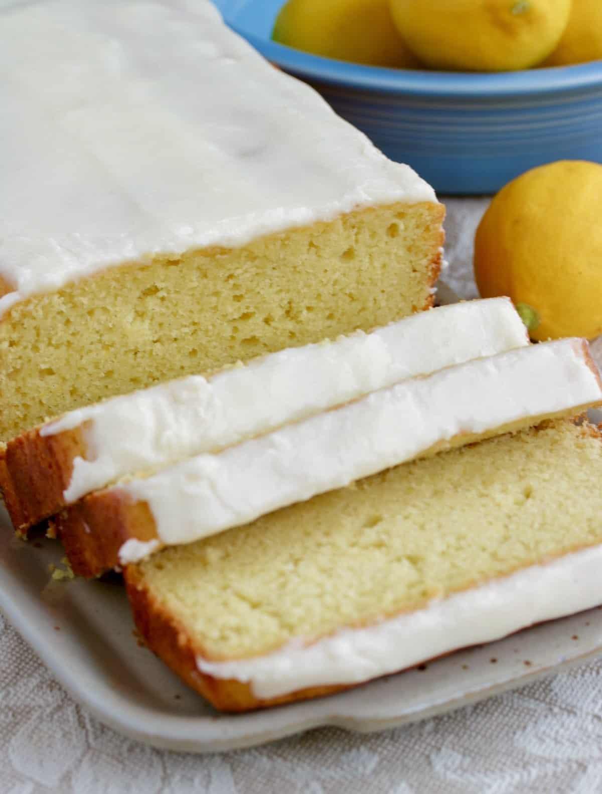 sliced lemon cake with fresh lemon