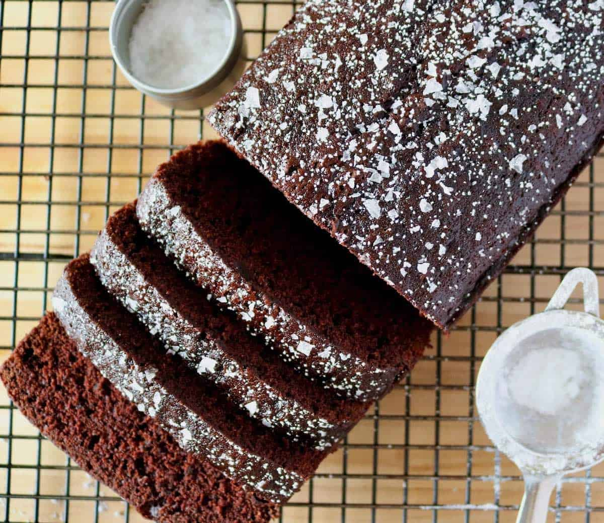 sliced Salted Chocolate Pear Pound Cake with salt and powdered sugar