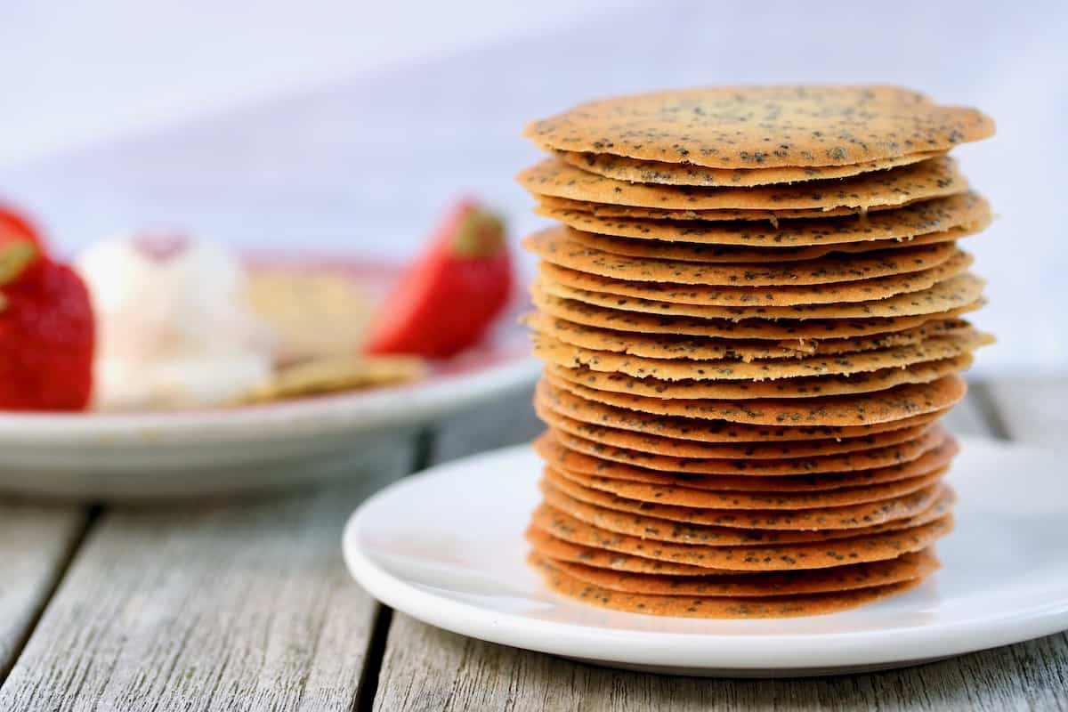 the best poppy seed cookies stacked on a plate