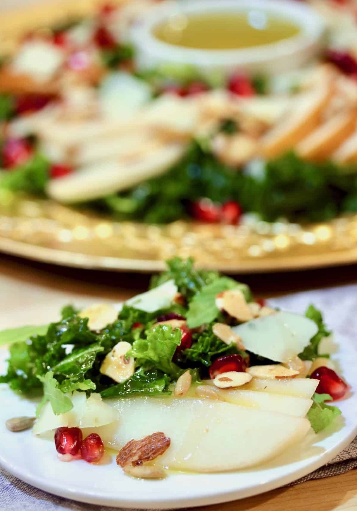 pears, kale, pomegranate seeds, nuts salad plated