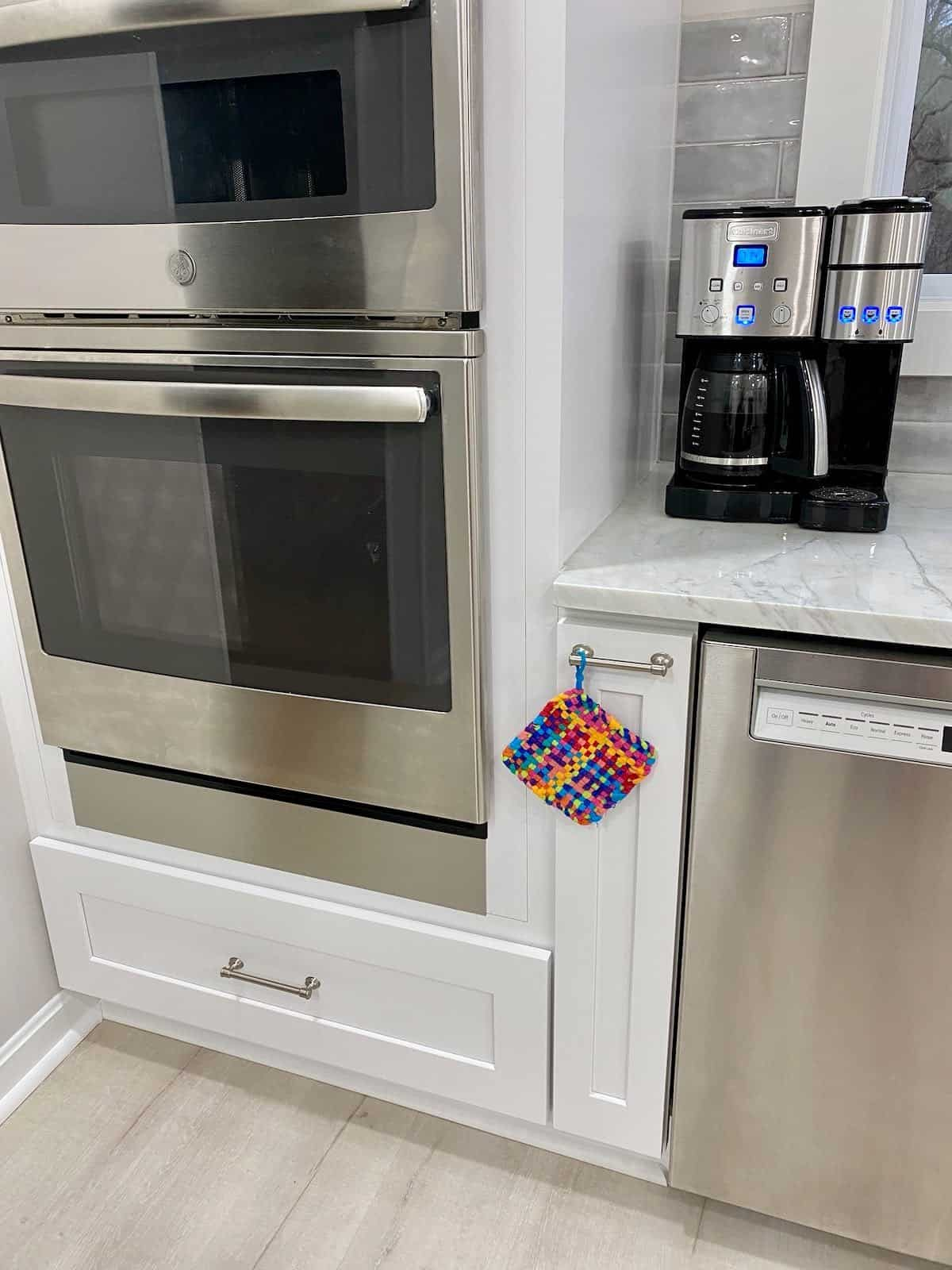 kitchen reveal with a rainbow potholder