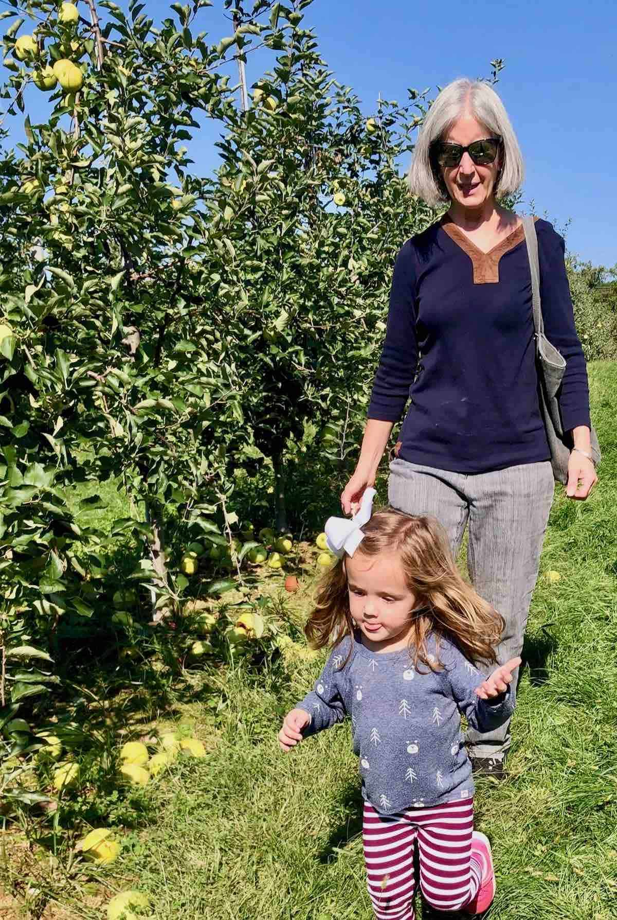 me and my grand daughter in apple orchard