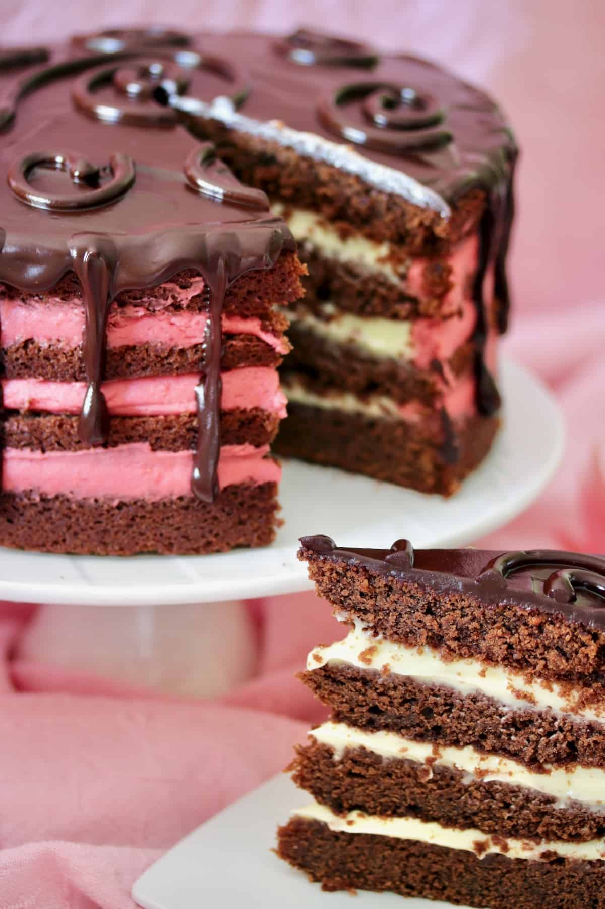 slice of chocolate drip layer cake