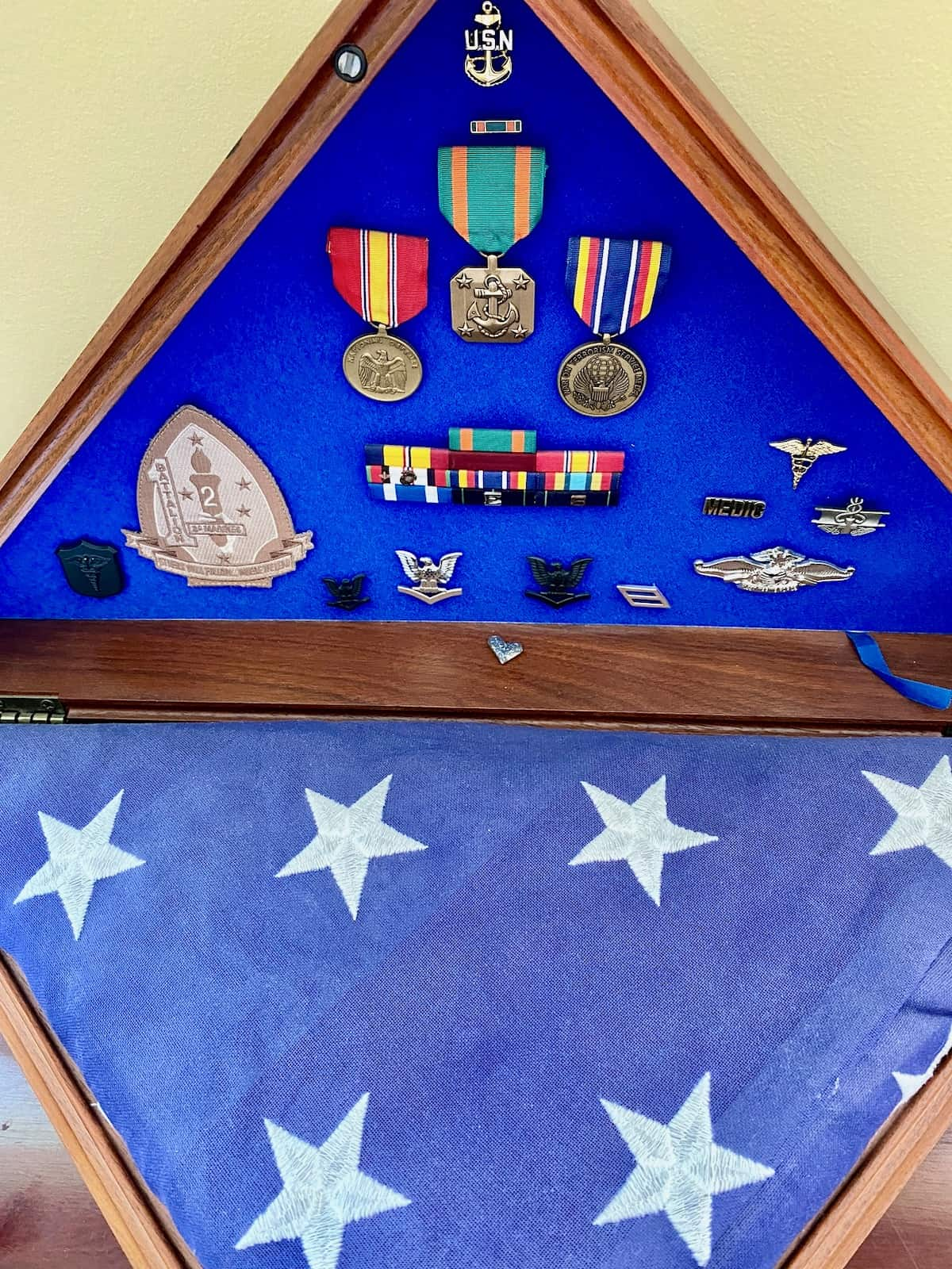 Ten years memorial flag and medals remain on display