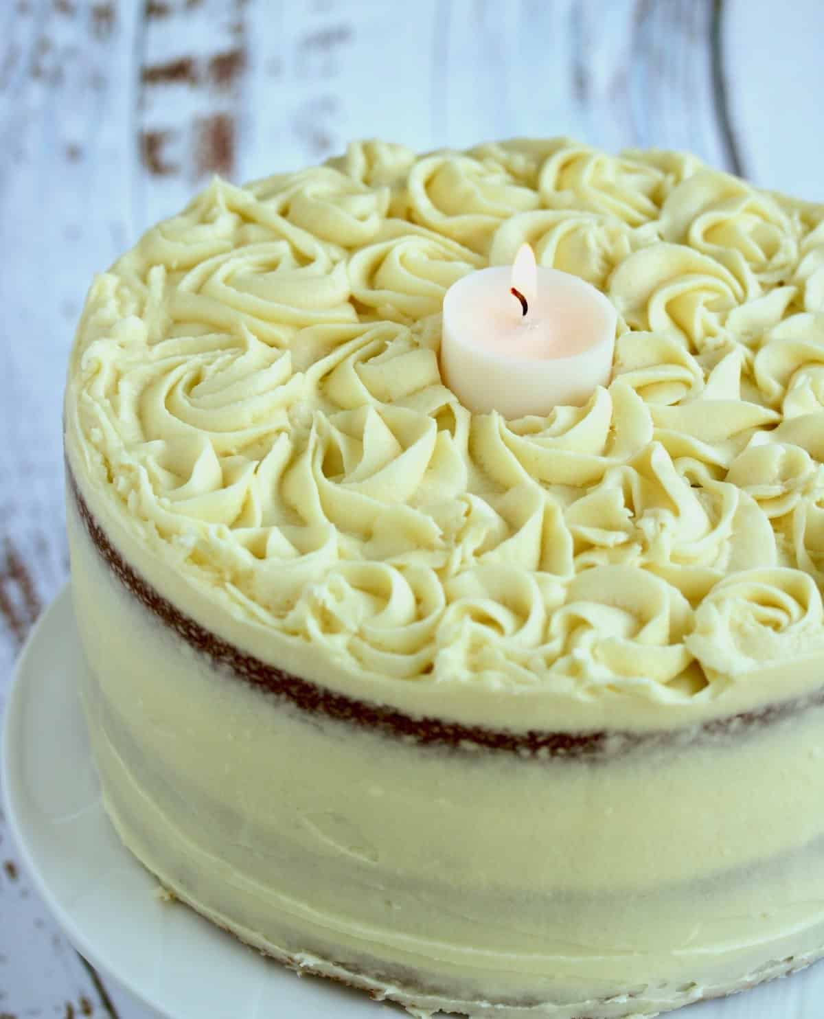 buttermilk cake with a candle to celebrate a life